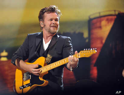 John Mellencamp performs during the Farm Aid 2013 concert at Saratoga Performing Arts Center in Saratoga Springs, N.Y., Sept. 21, 2013.