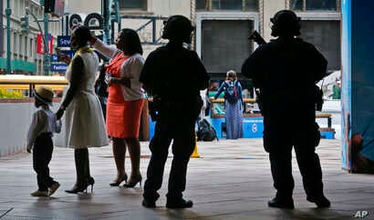 A New York Police Department anti-terror unit guard an entry area to Madison Square Garden as families arrive for a graduation ceremony, May 23, 2017, in New York.