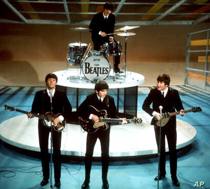 "FILE - In this Feb. 9, 1964 file photo, The Beatles perform on the CBS ""Ed Sullivan Show"" in New York."