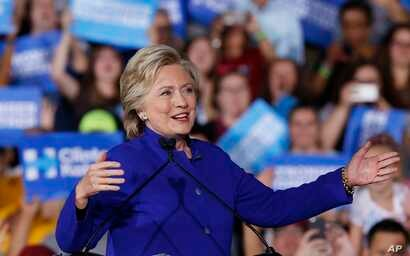 Democratic presidential candidate Hillary Clinton speaks at a campaign rally, Nov. 2, 2016, in Tempe, Ariz.