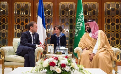 In this Nov. 9, 2017, photo released by Saudi Press Agency, SPA, Saudi Crown Prince Mohammed bin Salman meets with French President Emmanuel Macron upon his arrival in Riyadh, Saudi Arabia.