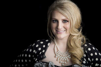 "American singer, songwriter and record producer known for the pop single ""All About That Bass"" Meghan Trainor poses for a portrait, on Aug. 7, 2014 in New York."