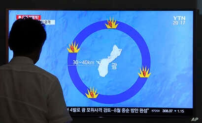 A man watches a TV screen showing a local news program reporting on North Korea's threats to strike Guam with ballistic missiles, at the Seoul Train Station in Seoul, South Korea, Aug. 10, 2017.