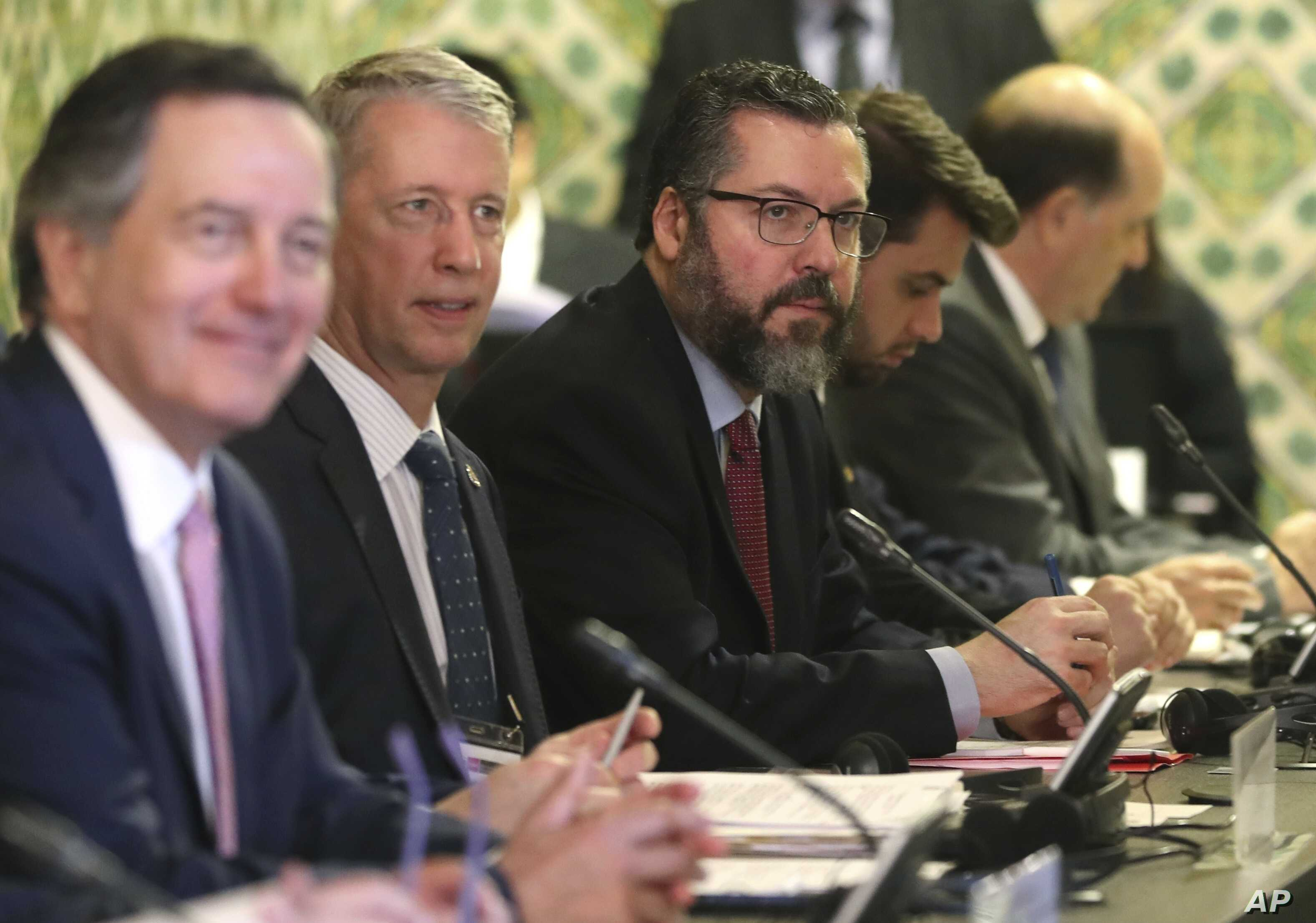 Brazil's Foreign Minister Ernesto Araujo, center, attends a meeting of the Lima Group concerning Venezuela in Lima, Peru, Jan. 4, 2019.