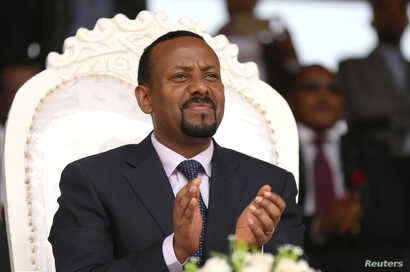 FILE - Ethiopia's newly elected prime minister, Abiy Ahmed, attends a rally during his visit to Ambo in the Oromiya region of  Ethiopia, April 11, 2018. Abiy was not hurt in an explosion that went off shortly after he spoke to a rally in Addis Ababa....