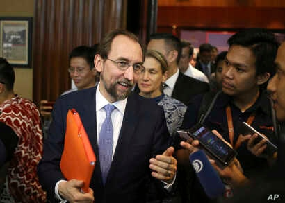 The U.N.'s human rights chief Zeid Ra'ad al-Hussein, center, answers reporters' questions after attending a conference in Jakarta, Indonesia, Feb. 5, 2018. Al-Hussein warned that Myanmar's persecution of the Rohingya Muslim minority has the potential...