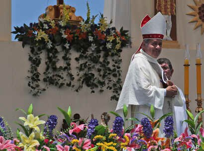 FILE - Osornos Bishop Juan Barros smiles as he leaves the altar after Mass was celebrated by Pope Francis on Lobito Beach in Iquique, Chile, Jan. 18, 2018.