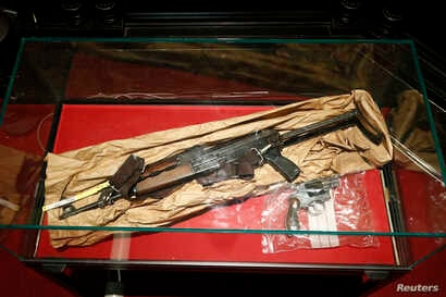 Evidence is displayed at the trial of Mehdi Nemmouche at the Justice Palace in Brussels, Jan. 10, 2019. Mehdi Nemmouche is accused of shooting dead four people at a Jewish museum in Belgium in 2014.