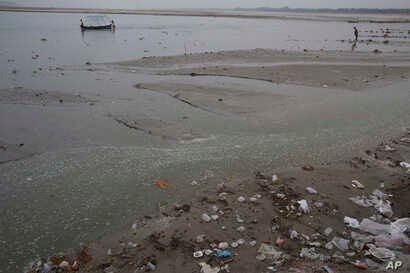 Plastic bags and garbage is littered on the banks of River Ganges on World Environment Day in Allahabad, India, June 5 ,2017.