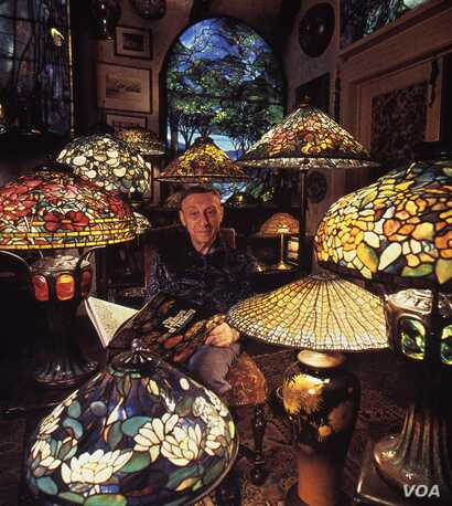 "Dr. Egon Neustadt among his Tiffany lamps, installed in his ""apartment-museum,"" originally located in his townhouse on New York's Upper East Side."