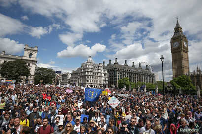 FILE - Protestors hold banners in Parliament Square during a 'March for Europe' demonstration against Britain's decision to leave the European Union, central London, Britain, July 2, 2016.