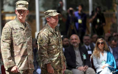 Outgoing U.S. Army Gen. John Nicholson, left, and incoming U.S. Army Gen. Austin Miller, second from left, prepare for the change of command ceremony at Resolute Support headquarters in Kabul, Afghanistan, Sept. 2, 2018.