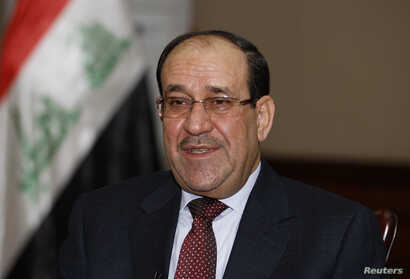 Iraq's Prime Minister Nuri al-Maliki speaks during an interview with Reuters in Baghdad January 12, 2014. Iraqi Prime Minister Nuri al-Maliki, in a striking change of course, is embracing the Sunni Muslim tribal fighters whose role in combating al Qa...