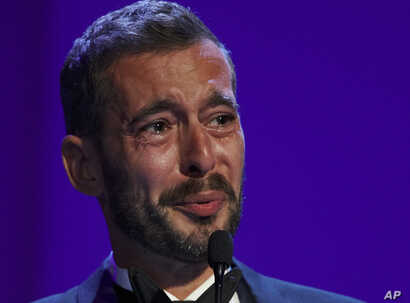 """Director Xavier Legrand gets emotional after being awarded the Silver Lion for best director for """"Jusqu'a la Garde"""" during the awards ceremony at the 74th Venice Film Festival at the Venice Lido, Italy, Sept. 9, 2017."""