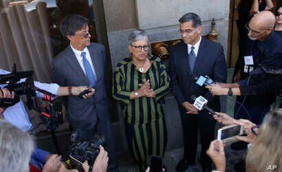 California leaders, from left to right, Cal/EPA Secretary Matthew Rodriguez, California Air Resources Board Chair Mary Nichols and California Attorney General Xavier Becerra talk to the media after speaking during the first of three public hearings o...