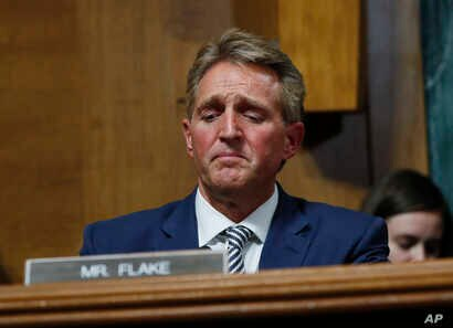 Sen. Jeff Flake speaks during the Senate Judiciary Committee hearing about Brett Kavanaugh's nomination for the Supreme Court. After a flurry of last-minute negotiations, the committee advanced Kavanaugh after agreeing to a call from Flake for a one