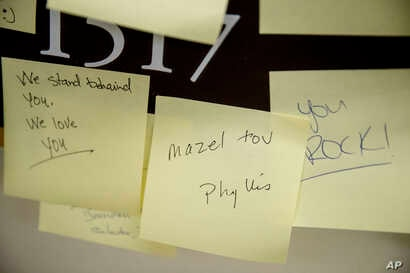 People leave post-it notes of support outside the office of Rep. Ilhan Omar, D-Minn., on Capitol Hill, Feb. 11, 2019, in Washington.