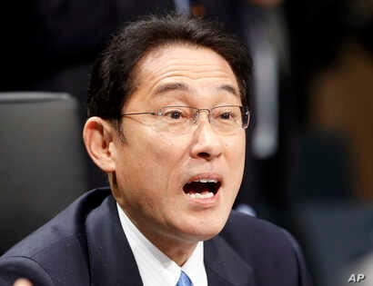 Japan's Foreign Minister Fumio Kishida speaks during the second day of the G-20 Foreign Ministers meeting in Bonn, Germany, Feb. 17, 2017.(AP Photo/Michael Probst)