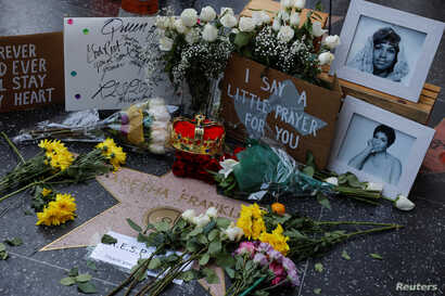 A crown, flowers and pictures are shown placed at Aretha Franklin's star on Hollywood Boulevard in Los Angeles, California, Aug. 16, 2018.