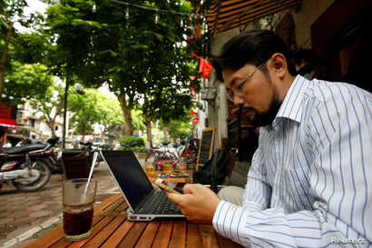 Vietnamese activist Anh Chi searches the internet at Tu Do (Freedom) cafe in Hanoi, Vietnam August 25, 2017.