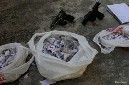 Drugs and guns seized from suspects arrested during violent clashes with Brazilian Army soldiers in Rio de Janeiro, Brazil, Aug. 20, 2018.