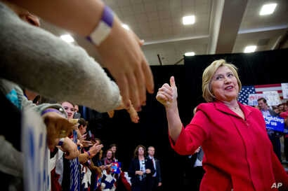 Democratic presidential candidate Hillary Clinton, center, arrives to speak at a get out the vote event at Transylvania University in Lexington, Ky., May 16, 2016.
