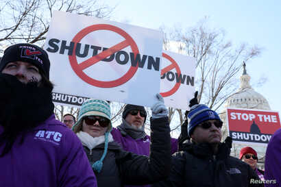 Federal air traffic controller union members protest the partial U.S. federal government shutdown in a rally at the U.S. Capitol in Washington, U.S. Jan. 10, 2019.