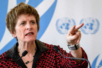 FILE - United Nations Deputy High Commissioner for Human Rights, Kate Gilmore, gestures while delivering a statement during the U.N. Human Rights Council session in Geneva, Switzerland, March 13, 2018.