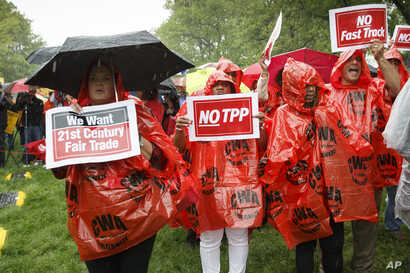 FILE - Demonstrators rally for fair trade at the Capitol in Washington.
