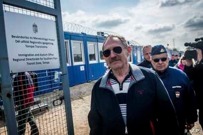 Hungarian Interior Minister Sandor Pinter, foreground,  inspects the enlarged transit zone set up for migrants at the country's southern border with Serbia near Tompa, 169 kms southeast of Budapest, April 6, 2017.