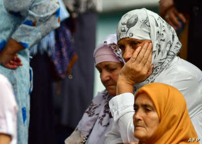 Bosnian Muslim women are seen while people gather in front of the central mosque in Srebrenica on July 25, 2018, to pay last respects to late Hatidza Mehmedovic, who passed away on July 22.