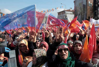 People listen to Turkey's President Recep Tayyip Erdogan during a rally of his ruling Justice and Development Party (AKP), in Ankara, Turkey, March 14, 2019, ahead of local elections scheduled for March 31.