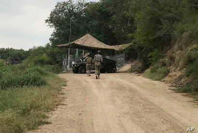 U.S. National Guard troops guard the border in Roma, Texas, April 10, 2018.