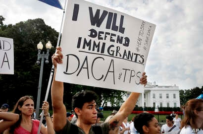 Diego Rios, 23, of Rockville, Md., rallies in support of the Deferred Action for Childhood Arrivals program outside of the White House, in Washington, Sept. 5, 2017.