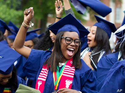 Ciearra Jefferson celebrates her graduation with her class after President Barack Obama spoke at Howard University's commencement exercises in Washington, May 7, 2016.