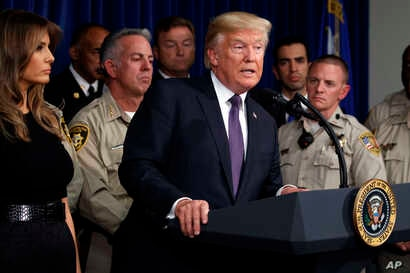 President Donald Trump speaks after meeting with first responders and private citizens who helped during the mass shooting, at the Las Vegas Metropolitan Police Department, Oct. 4, 2017, in Las Vegas.