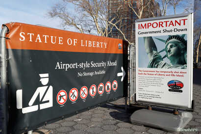 A sign announcing the closure of the Statue of Liberty, due to the U.S. government shutdown, sits near the ferry dock to the Statue of Liberty at Battery Park in Manhattan, New York, Jan. 20, 2018.