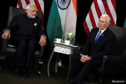 India's Prime Minister Narendra Modi and U.S. Vice President Mike Pence hold a bilateral meeting in Singapore, Nov. 14, 2018.