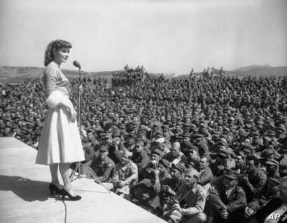 Debbie Reynolds entertaines at 8th Army headquarters in Seoul, South Korea, May 23, 1955.