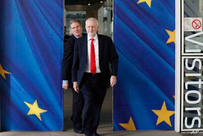 British Labour Party leader Jeremy Corbyn, right, and Keir Starmer, Labour Shadow Brexit secretary, leave EU headquarters prior to an EU summit in Brussels, Belgium, March 21, 2019.