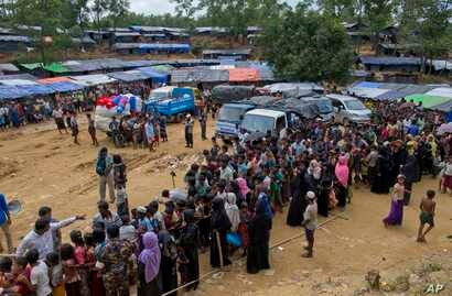 Newly arrived Rohingya refugees stand in a line to receive food rations in Kutupalong, Bangladesh, Sept. 30, 2017. As of Thursday, U.N. deputy spokesman Farhan Haq said, the U.N. and its humanitarian partners have received $36.4 million — just under