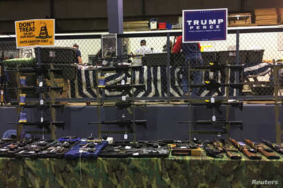 Guns are on display inside the Ohio Gun, Knife & Military Show at the Summit County Fairgrounds in Tallmadge, Ohio, Oct. 30, 2016.