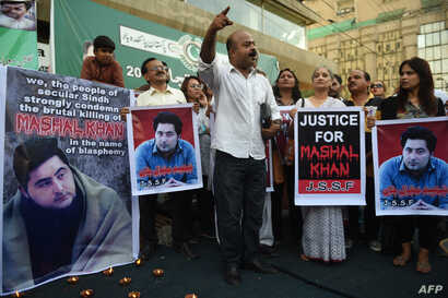 Pakistani demonstrators take part in a protest the killing of journalism student Mashal Khan in Karachi on April 22, 2017.