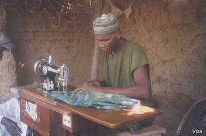 ElecElectricity has enabled people in some areas of northern Nigeria to open businesses, such as this man's tailoring enterprise