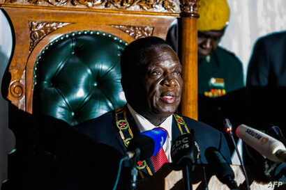 Zimbabwean President Emmerson Mnangagwa delivers his state of the nation address at a joint sitting of the parliament and the senate in Harare on December 20, 2017.