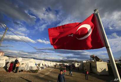 FILE -  A Turkish flag flies at the refugee camp for Syrian refugees in Islahiye, Gaziantep province, southeastern Turkey, March 16, 2016.