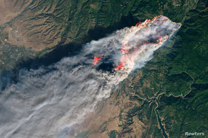 NASA's Operational Land Imager satellite image shows the Camp Fire burning at around 10:45 a.m. local time near Paradise, California, on Nov. 8, 2018.