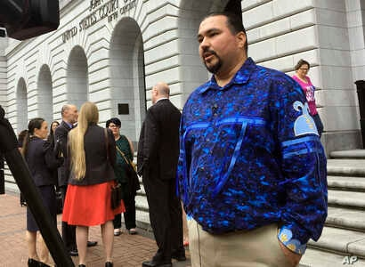 Tehassi Hill, tribal chairman of the Oneida Nation, stands outside a federal appeals court, March 13, 2019 in New Orleans.