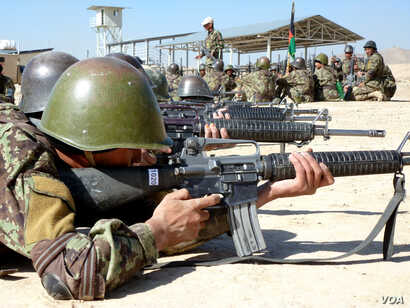 Afghan soldiers train with their weapons at the Kabul Military Training Center on the outskirts of the Afghan capital, November 11, 2012. The Afghan army is preparing for the withdrawal of international combat troops in 2014 when they will assume ful...