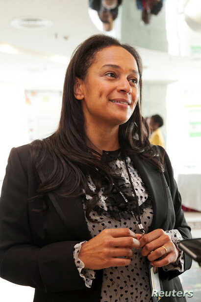 FILE - Isabel dos Santos, the daughter of Angolan President Jose Eduardo dos Santos and head of state energy giant Sonangol, speaks during an interview in Luanda, Angola, June 9, 2016.